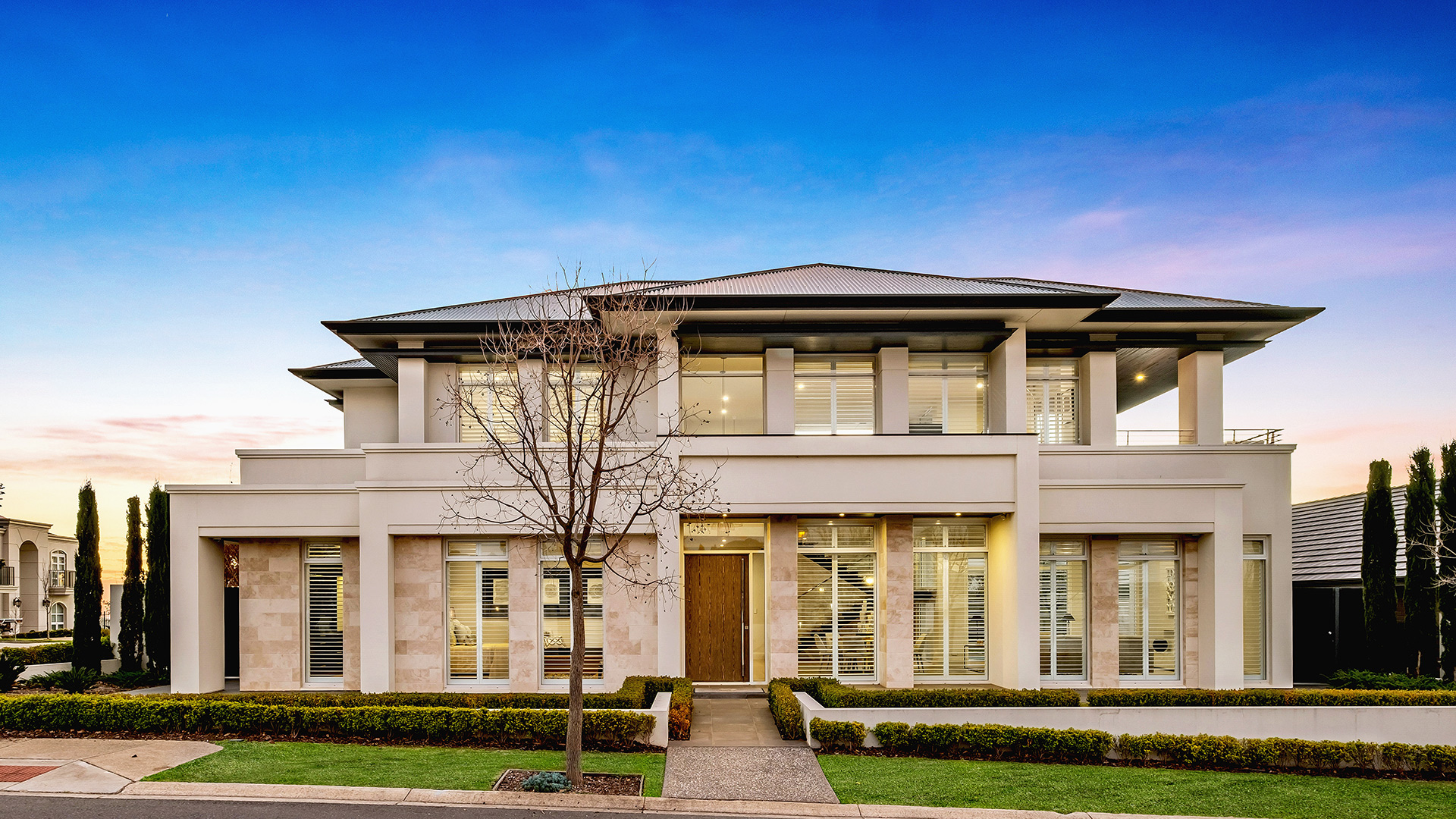 stunning image of the front facade of the grand prize home